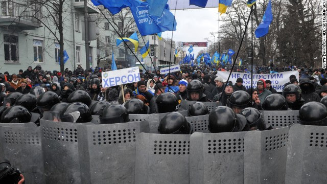 Riot police block protesters during the December 8 rally in Kiev.