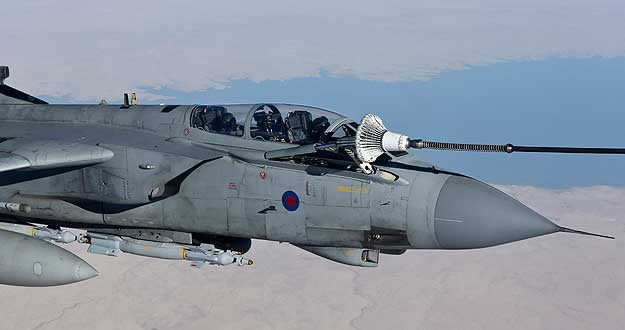 An RAF Tornado GR4 refuels from a Voyager tanker during it's first combat mission flown out of Akrotiri, Cyprus