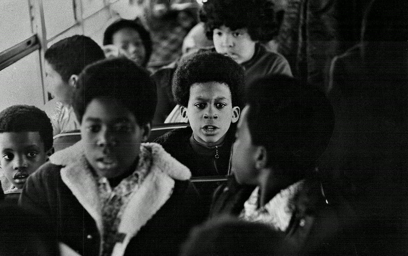 "Description of  FEB 18 1974 - Children head home at day's end. ""The word integration is extremely important. I also think hand in hand with that goes quality education. If you let these kids go into a white school and call it quits with that .. it's meaningless."" Mrs. Frances Aschkinasi. (David Cupp/The Denver Post)"