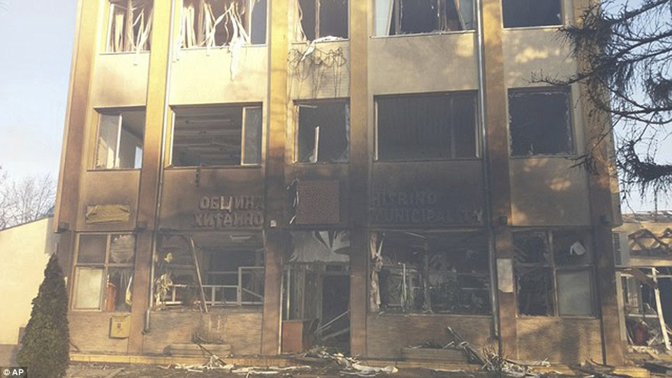 In this photo released by the Bulgarian Interior Ministry shows a municipality building after the explosion
