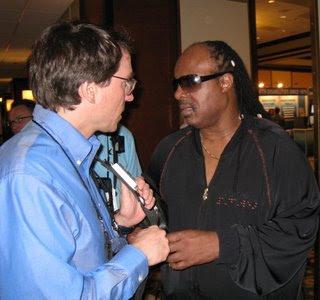 Charles demonstrating Talking Lights to Stevie Wonder