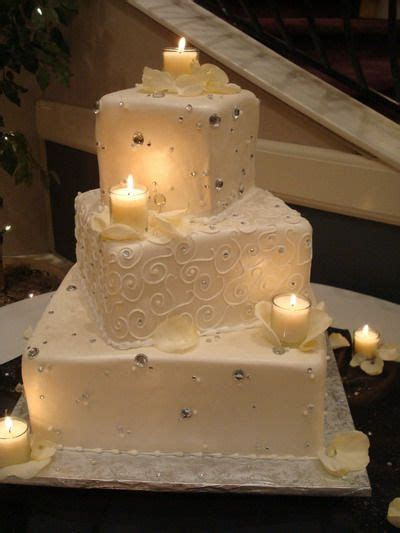 A three tier wedding cake decorated with silver beads