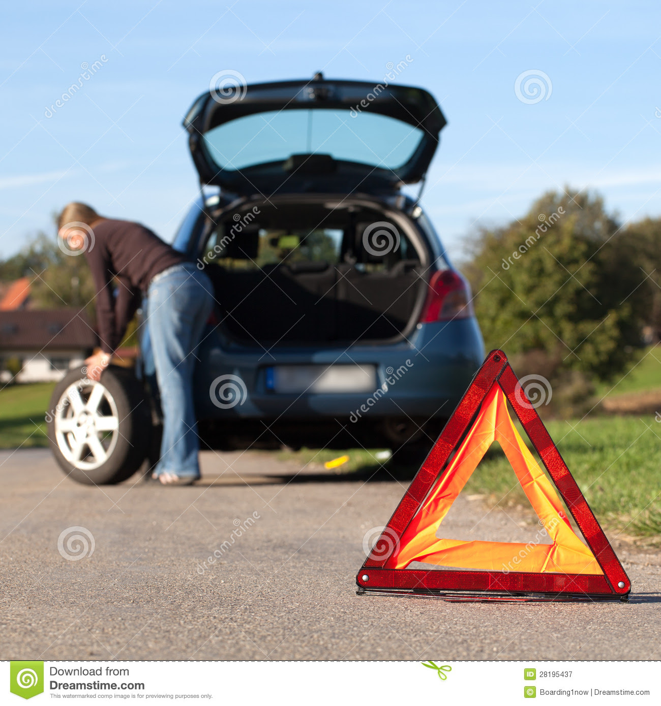 Changing The Tire On A Broken Down Car Stock Image Image 28195437