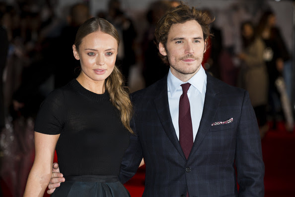 """Laura Haddock and Sam Claflin attend the World Premiere of """"Love, Rosie"""" at Odeon West End on October 6, 2014 in London, England."""