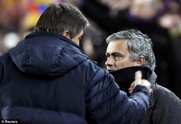Opposition: Mourinho talked to Barcelona's assistant coach Jordi Roura before the match