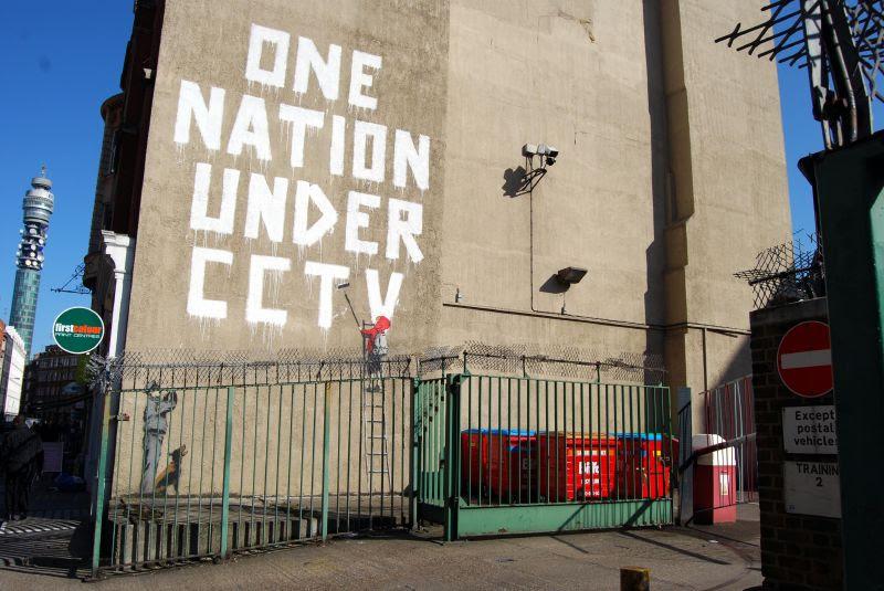http://upload.wikimedia.org/wikipedia/commons/8/8a/Bansky_one_nation_under_cctv.jpg