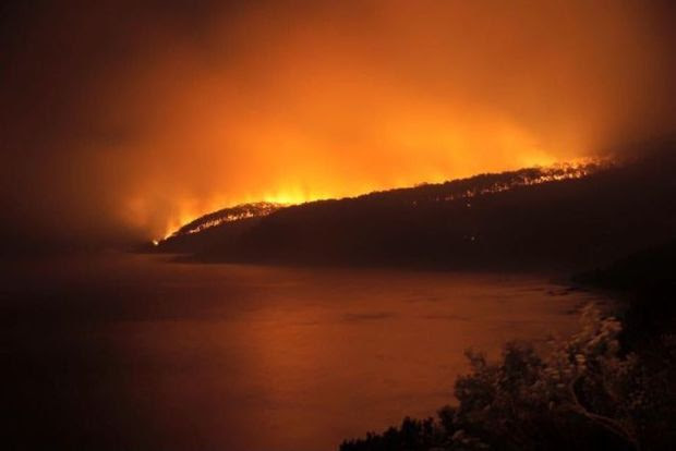 A fire raging overnight has destroyed 50 homes in Victoria.