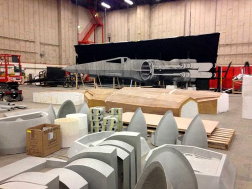 An updated X-Wing starfighter undergoes construction for STAR WARS: EPISODE VII.