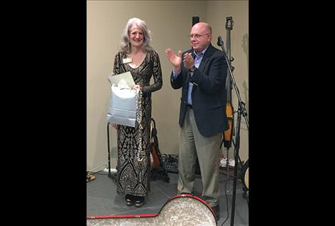Twentieth Judicial District Judge Deborah Kim Christopher, left, president of the Montana Judges Association, is honored by retired District Court Judge and former Association president Mike Salvagni.