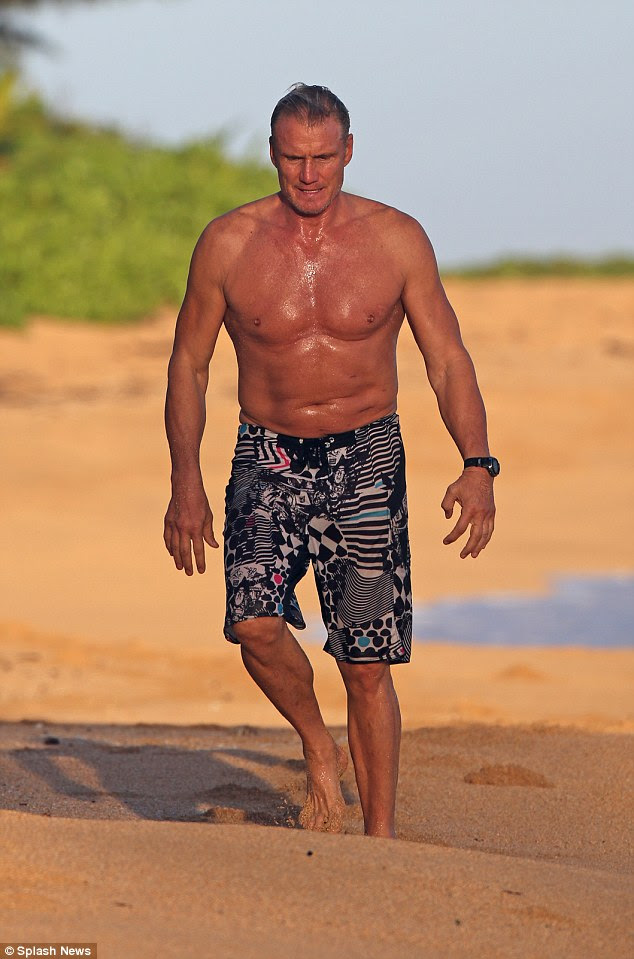 Beach break: Dolph has been in Hawaii filming scenes for fantasy horror film, Don't Kill It where he stars as a grizzled old demon hunter tasked with fighting off an ancient demon that haunts an Alaskan town