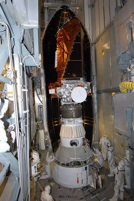 At Cape Canaveral Air Force Station in Florida, technicians prepare to install the Delta II rocket's payload fairing around the KEPLER spacecraft (2/26/09).