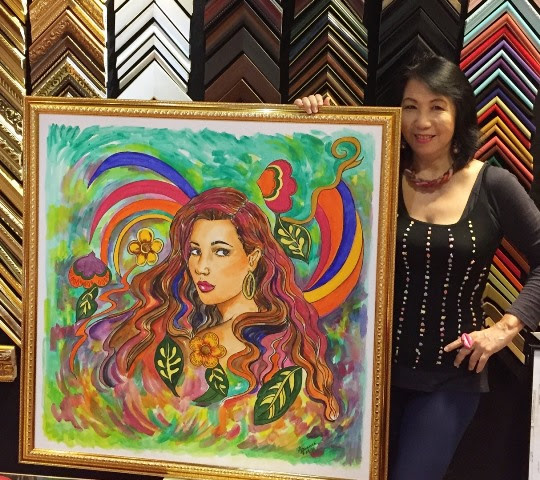 ginny-with-the-center-piece-of-her-art-exhibit-the-biggest-one-done-in-acrylic-on-a-36-x-36-canvas