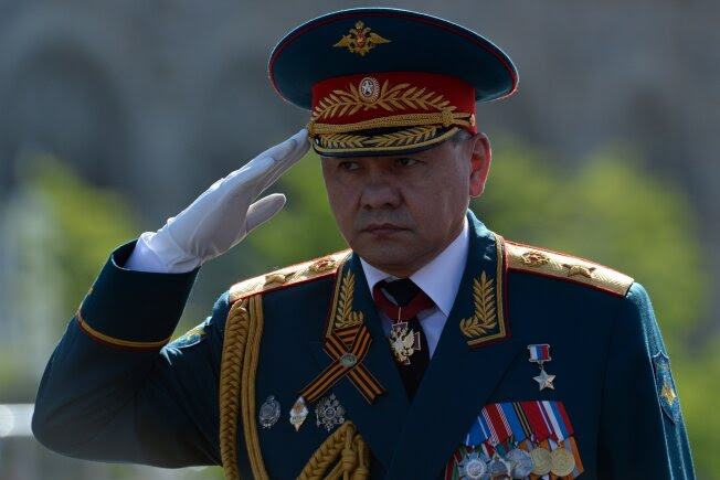 Russian Defense Minister Sergei Shoigu makes the military salute at the Red Square in Moscow, on May  9, 2014, during a Victory Day parade.