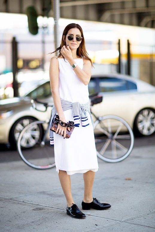 Le Fashion Blog Summer Street Style Gala Gonzalez White Dress Striped Shirt Tied Around The Waist Clutch Black Leather Oxfords Via Style Caster