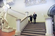 Russian Prime Minister Vladimir Putin, right, walks with Irina Antonova, director of the Pushkin Fine Arts Museum as he visits an exhibition of Caravaggio works from the Pinacoteca of Vatican in the Pushkin Fine Arts Museum in Moscow, Tuesday, Dec. 6, 2011. (AP Photo/RIA Novosti, Yana Lapikova, Pool)