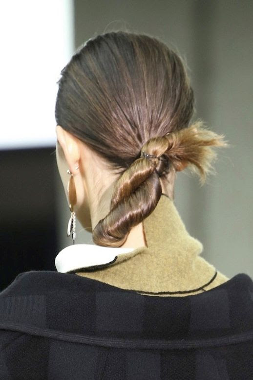 LE FASHION BLOG HAIR INSPIRATION TWISTED CHIGNON CELINE FW 2014 SLICKED BACK LOW TWIST BUN ONE STATEMENT EARRING PARIS FASHION WEEK 2 photo LEFASHIONBLOGHAIRINSPIRATIONTWISTEDCHIGNONCELINEFW20142.jpg