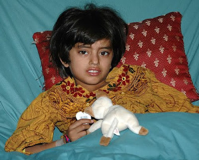 child in hospital with stuffed animal