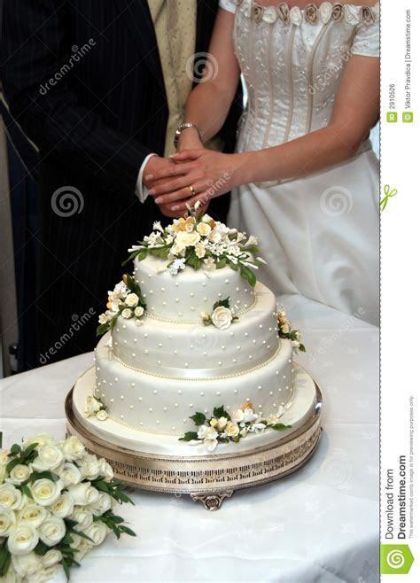Cutting the wedding cake stock photo. Image of fashion
