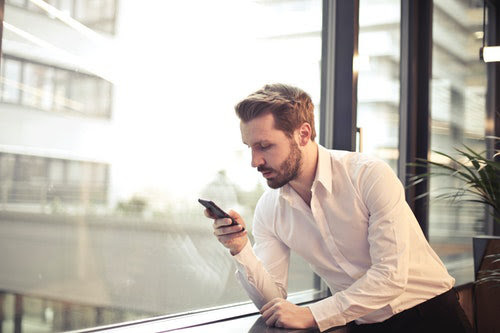 Businessman using business apps at office