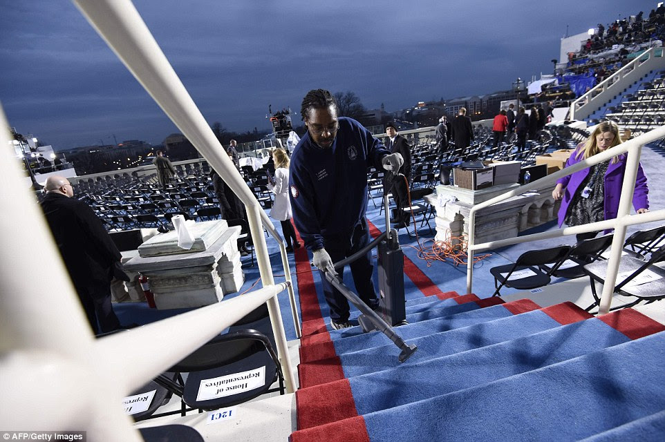 A worker cleans steps on the inaugural stand on January 20, 2017, at the U.S. Capitol in Washington, DC, before the inauguration of US President-elect Donald Trump