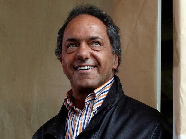 Candidato Daniel Scioli durante votação nas eleições deste domingo (25) em Buenos Aires, Argentina (Foto: ReutersMartin Acosta)