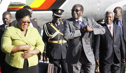 Republic of Zimbabwe Vice President Joice Mujuru welcoming President Robert Mugabe from the African Union summit in Ethiopia on January 28, 2013. by Pan-African News Wire File Photos