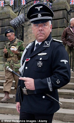 'Disgrace': A re-enactor sports a uniform of the SD, a branch of the SS, during last year's 1940s celebration in Haworth, West Yorkshire