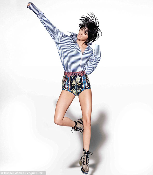 She's back: Kendall Jenner reminded fans of what she's famous for on Wednesday when she appeared in a kooky covershoot for Vogue, Brazil