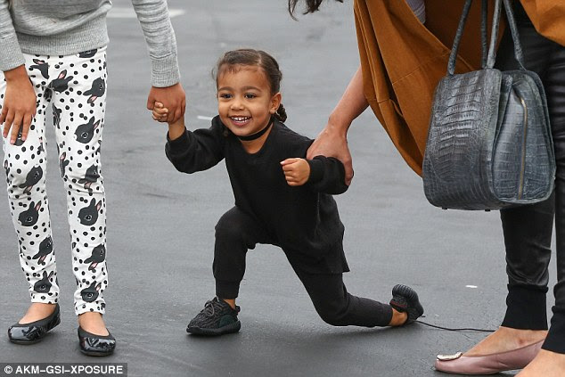 On your mark: North West beamed a big smile as mom Kim Kardashian treated her to a kid-sized shopping spree at Toys R Us in Woodland Hills, CA on Saturday