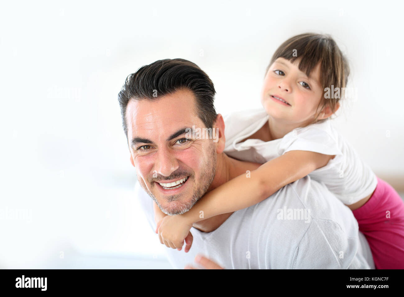 Daddy Carrying Little Girl On His Back Stock Photo 165198419 Alamy