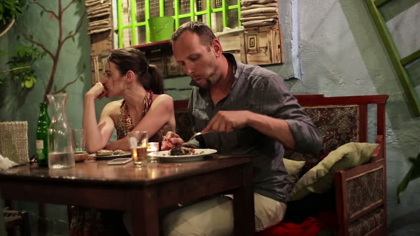 Image result for photo of unhappy couple at dinner