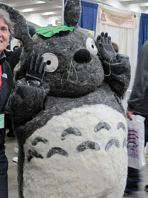 A cosplayer portraying Totoro from My Neighbor...