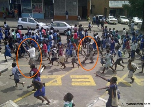 Malawian school children demonstrated on February 22, 2013 in Blantyre. The police are seeking to make arrest of adults associated with the protests. by Pan-African News Wire File Photos