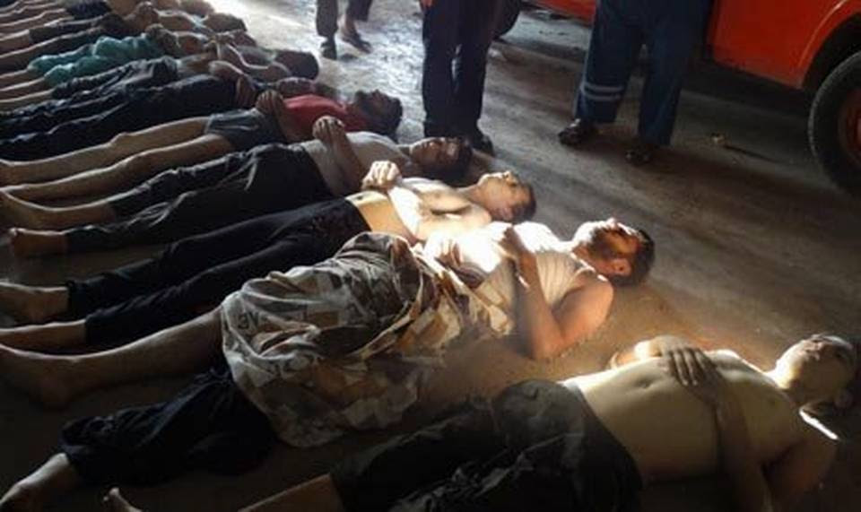 This image provided by Shaam News Network on Thursday, Aug. 22, 2013,  has been authenticated based on its contents and other AP reporting. It purports to show bodies of victims of an attack on Ghouta, Syria