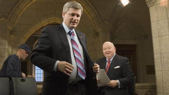 Prime Minister Stephen Harper walks away following a television interview with Mike Duffy in Ottawa in February 2007.