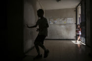 Boy runs for cover in Ashkelon, July 16,2014
