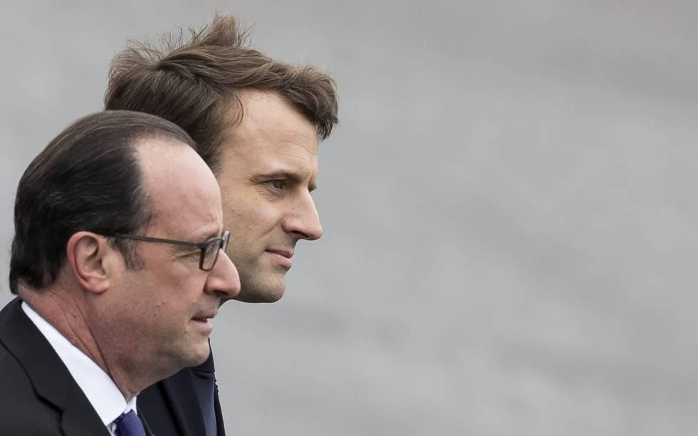 El presidente saliente francés, François Hollande y el mandatario electo de Francia, Emmanuel Macron, durante una ceremonia por el Día de la Victoria.