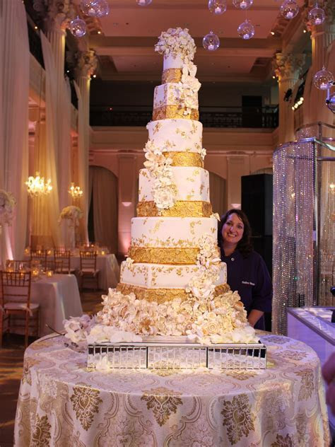 H Town chef's gold dusted, 12 tier wedding cake shakes up