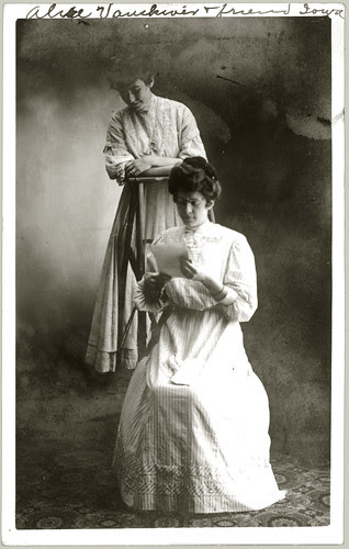 Two women reading note