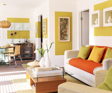 orange and green living room with white walls and furniture