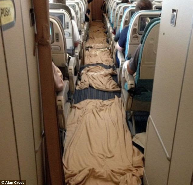 Mr Cross said the cabin crew and passengers were 'amazing' in the aftermath, as 'a calm and efficient clean-up' was underway