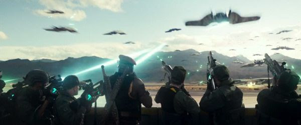 Human ground forces fire at strafing alien attackers in INDEPENDENCE DAY: RESURGENCE.