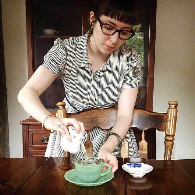preparing tea for guests.