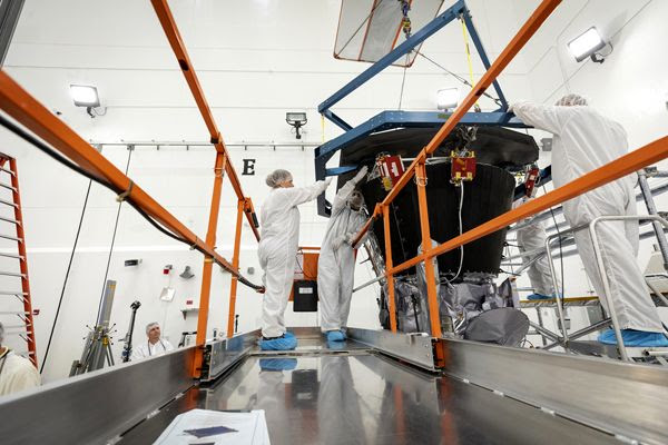 Engineers are about to install the Parker Solar Probe's heat shield inside the Astrotech Space Operations facility in Titusville, Florida...on June 27, 2018.