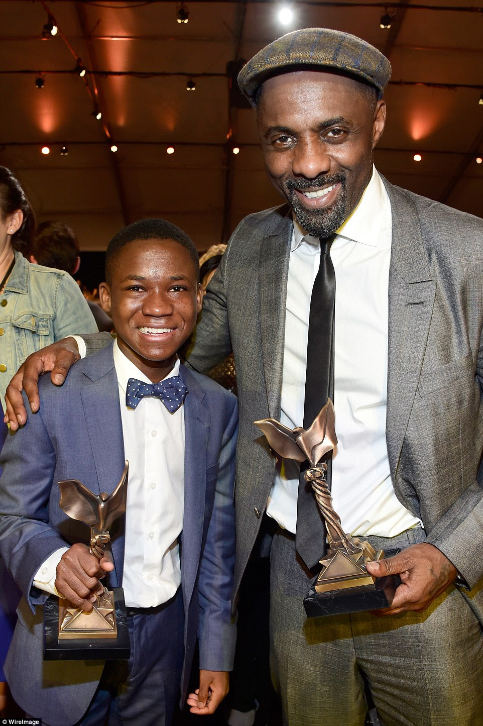Winning pair:Abraham Attah, winner of the Best Male Lead award for Beasts of No Nation posed alongside fellow winner Idris Elba