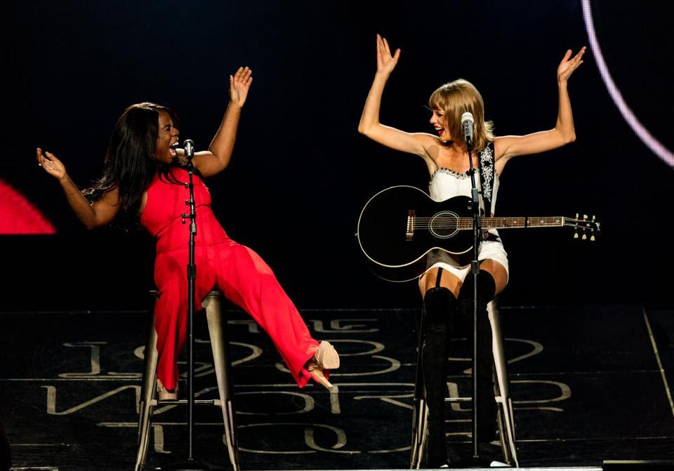 Actress Uzo Aduba (L) and singer-songwriter Taylor Swift perform onstage during Taylor Swift The 1989 World Tour Live In Los Angeles at Staples Center on August 22, 2015 in Los Angeles, California.