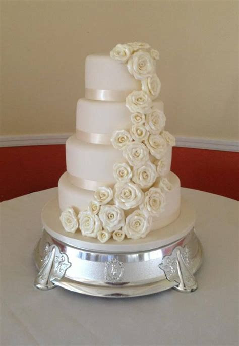 Large ivory 4 tier wedding cake with cascading handmade