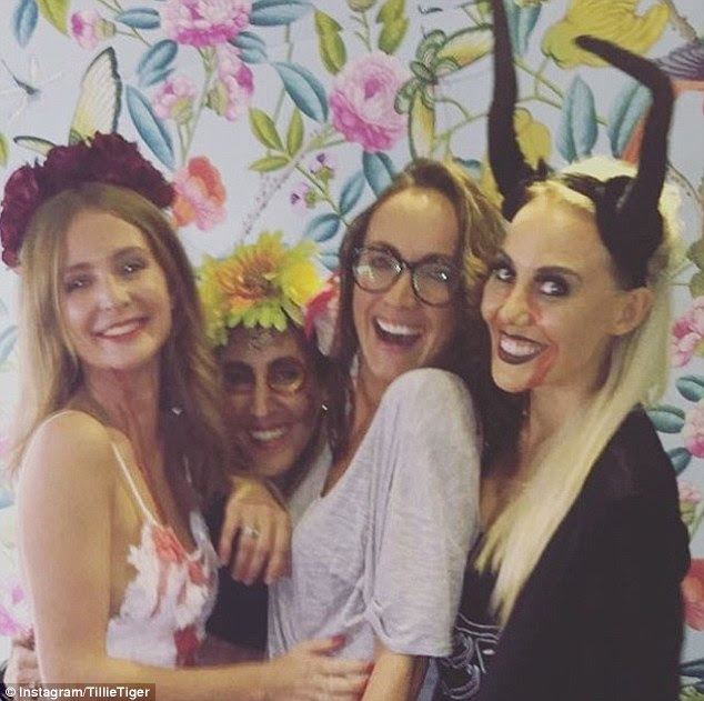Moving on! Millie Mackintosh, 27, 'ripped' and 'bloodied' her £1,500 Grace Loves Lace wedding reception gown to create her Halloween costume this year, according to The Sun