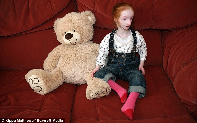 Pocket-sze: Charlotte is barely bigger than a newborn and smaller than some of her teddies