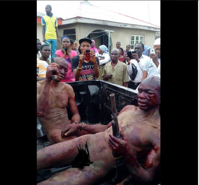 Massive Beating by Mob Strips Armed Robbers In Ogun State (Graphic Photos)